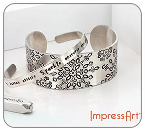 Immagine che mostra degli anelli realizzati con Impress Art
